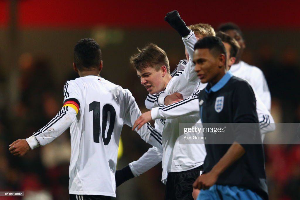 Max Besuschkow (C) of Germany celebrates his team's second goal with team mates during the U16 international friendly match between Germany and England at Suedstadion on February 13, 2013 in Cologne, Germany.