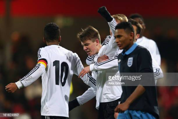 Max Besuschkow of Germany celebrates his team's second goal with team mates during the U16 international friendly match between Germany and England...