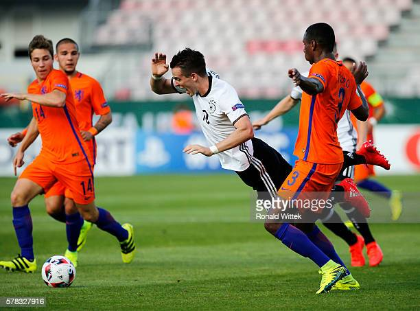 Max Besuschkow of Germany is challenged by Pablo Rosario of Netherlands during the UEFA Under19 European Championship match between U19 Germany and...