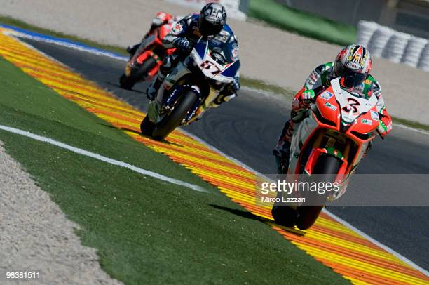 Max Biaggi of Italy and Aprilia Alitalia Racing lifts his front wheel during the qualifying practice session ahead of the Superbike Grand Prix Of...