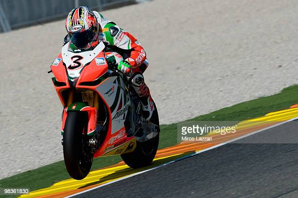 Max Biaggi of Italy and Aprilia Alitalia Racing lifts the front wheel during the first qualifying session at Comunitat Valenciana Ricardo Tormo...