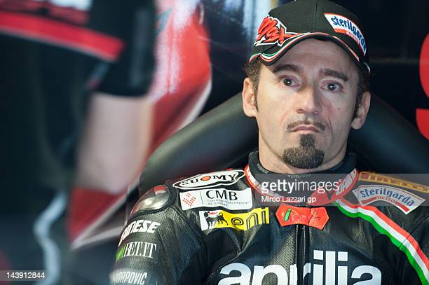 Max Biaggi of Italy and Aprilia Racing Team looks on in box during qualifying session of the Superbike World Championship Round Four at Autodromo di...