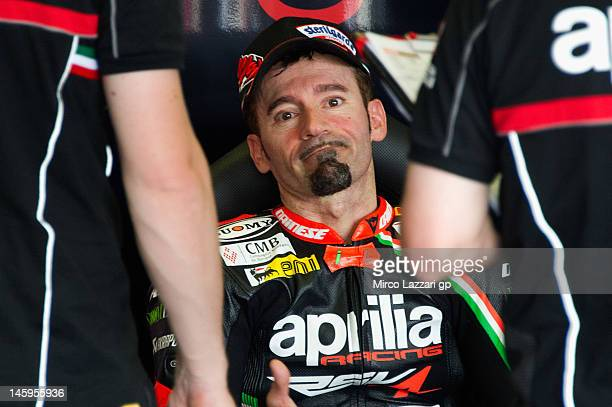 Max Biaggi of Italy and Aprilia Racing Team looks on in box during the first day of practice of round 7 of 2012 Superbike FIM World Championship at...