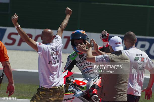 Max Biaggi of Italy and APRILIA RACING TEAM RED DEVILS greets the fans at the end of the WSBK Race 2 during the FIM Superbike World Championship Race...
