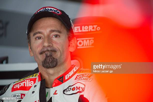 Max Biaggi of Italy and APRILIA RACING TEAM RED DEVILS looks on in box during the FIM Superbike World Championship Qualifying at Sepang Circuit on...