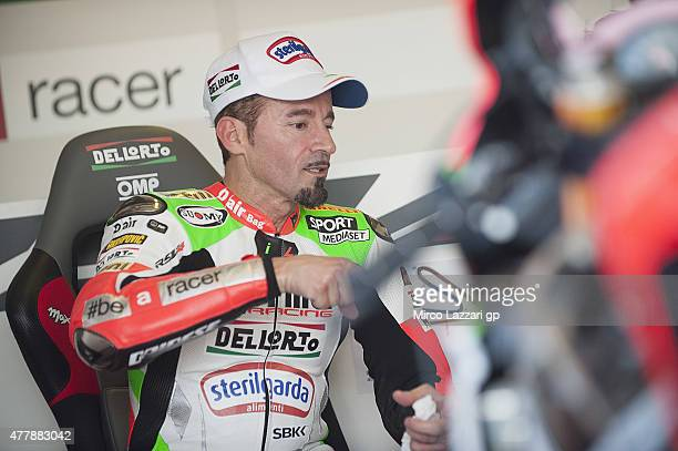 Max Biaggi of Italy and APRILIA RACING TEAM RED DEVILS speaks in box during the FIM Superbike World Championship Qualifying at Misano World Circuit...