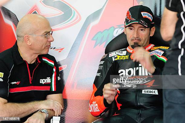 Max Biaggi of Italy and Aprilia Racing Team speaks in box with Aligi Deganello of Italy during the second round of the 2012 Superbike FIM World...