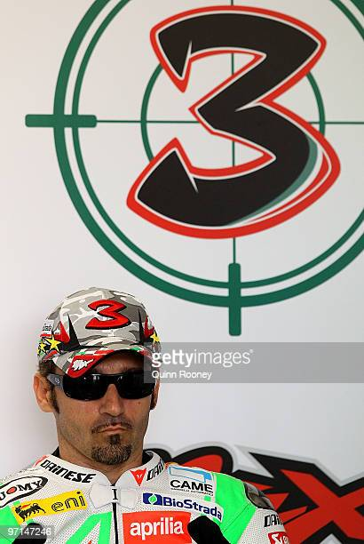 Max Biaggi of Italy and the Aprilia Alitalia Racing Team prepares in the pits before the Superbike World Championship round one race one at Phillip...