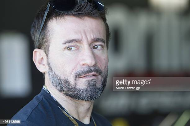 Max Biaggi of Italy looks on in paddock during the qualifying practice during the MotoGP of Valencia Qualifying at Ricardo Tormo Circuit on November...