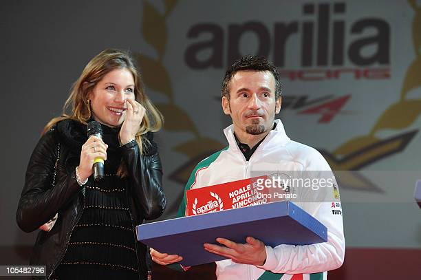 Max Biaggi with his wife Eleonora Pedron attend Aprilia's celebrations for winning the 2010 Superbike title on October 15 2010 in Noale Italy Aprilia...