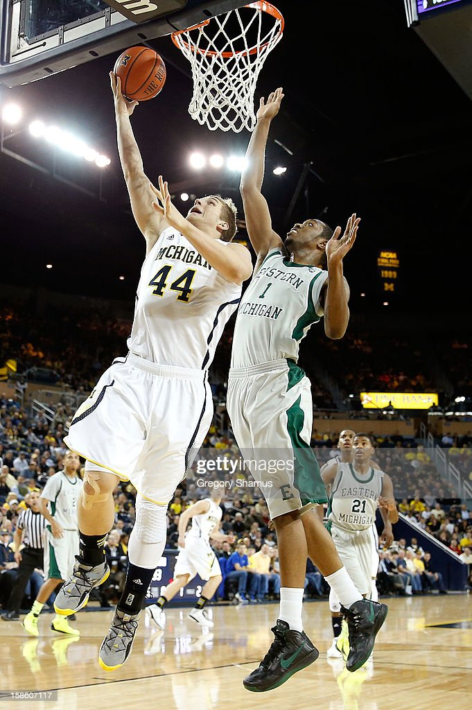 Max Bielfeldt #44 of the Michigan Wolverines gets to the basket for a first half layup in front of Da'Shonte Riley #1 of the Eastern Michigan Eagles at Crisler Center on December 20, 2012 in Ann Arbor, Michigan.