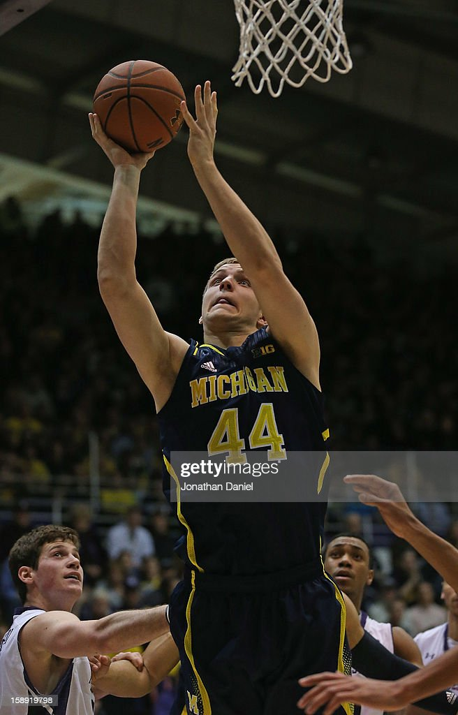 Max Bielfeldt #44 of the Michigan Wolverines puts up a shot against the Northwestern Wildcats at Welsh-Ryan Arena on January 3, 2013 in Evanston, Illinois. Michigan defeated Northwestern 94-66.