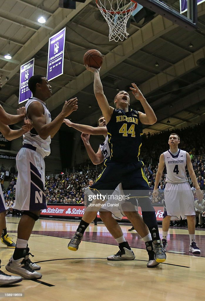 Max Bielfeldt #44 of the Michigan Wolverines puts up a shot past Alex Olah #22 of the Northwestern Wildcats at Welsh-Ryan Arena on January 3, 2013 in Evanston, Illinois. Michigan defeated Northwestern 94-66.