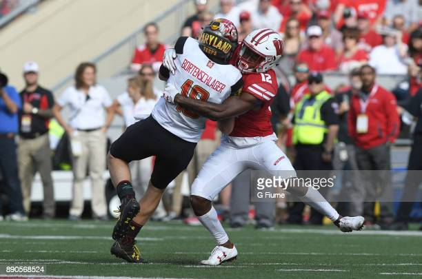 Max Bortenschlager of the Maryland Terrapins is tackled by Natrell Jamerson of the Wisconsin Badgers at Camp Randall Stadium on October 21 2017 in...