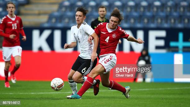 Max Brandt of Germany and Thomas Christiansen of Denmark compete for the ball during the Mens U17 international friendly match between Denmark and...