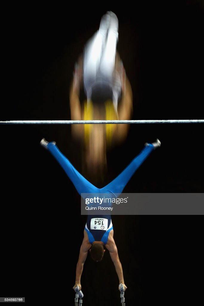 Max Chapman of Western Australia competes on the high bar as Benjamin Dempsey of New South Wales competes on the parrallel bars during the 2016 Australian Gymnastics Championships at Hisense Arena on May 27, 2016 in Melbourne, Australia.
