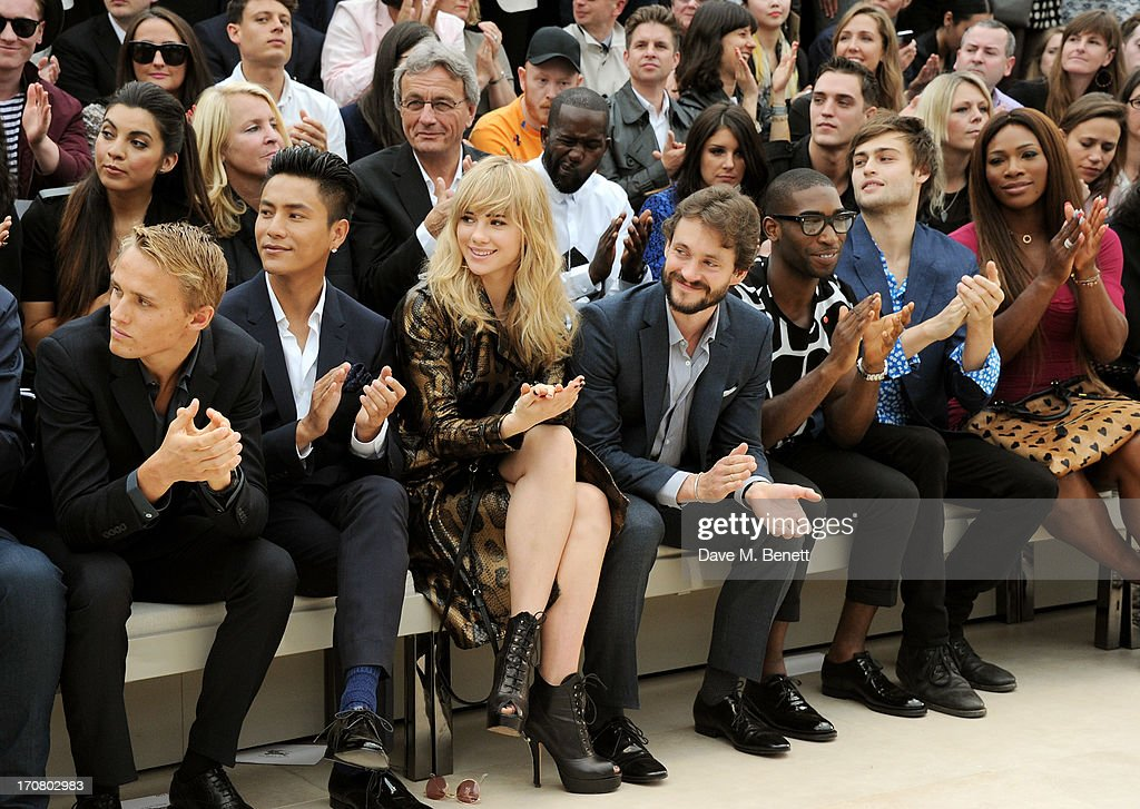 Max Chilton, Chen Kun, Suki Waterhouse, Hugh Dancy, Tinie Tempah, Douglas Booth and Serena Williams sit in the front row at Burberry Menswear Spring/Summer 2014 at Kensington Gardens on June 18, 2013 in London, England.