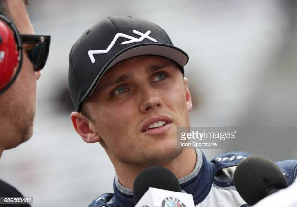 Max Chilton driver of the Chip Ganassi Racing Honda has his interview shortened as he watches the accident of Sebastien Bourdais driver of the Dale...