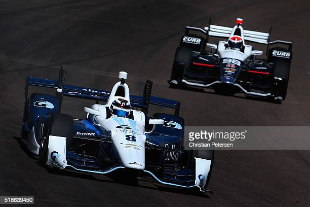 Max Chilton of England driver of the Chip Ganassi Racing Chevrolet IndyCar leads Alexander Rossi driver of the Andretti Herta Autosport Honda IndyCar...