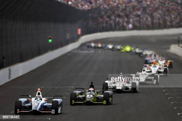 Max Chilton of England driver of the Gallagher Honda leads a pack of cars during the 101st Indianapolis 500 at Indianapolis Motorspeedway on May 28...