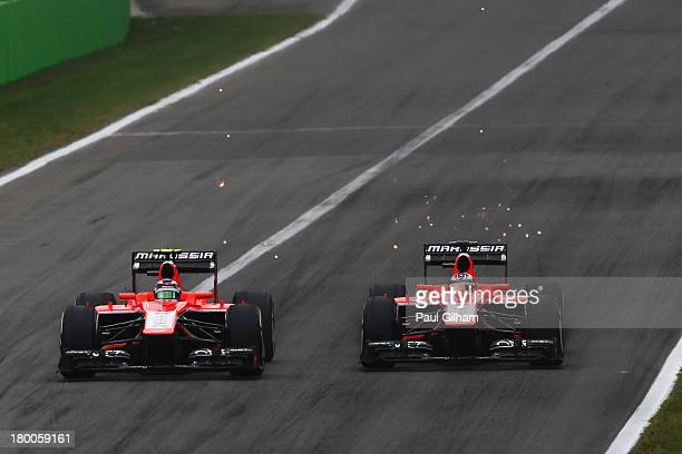 Max Chilton of Great Britain and Marussia and Jules Bianchi of France and Marussia drive side by side during the Italian Formula One Grand Prix at...