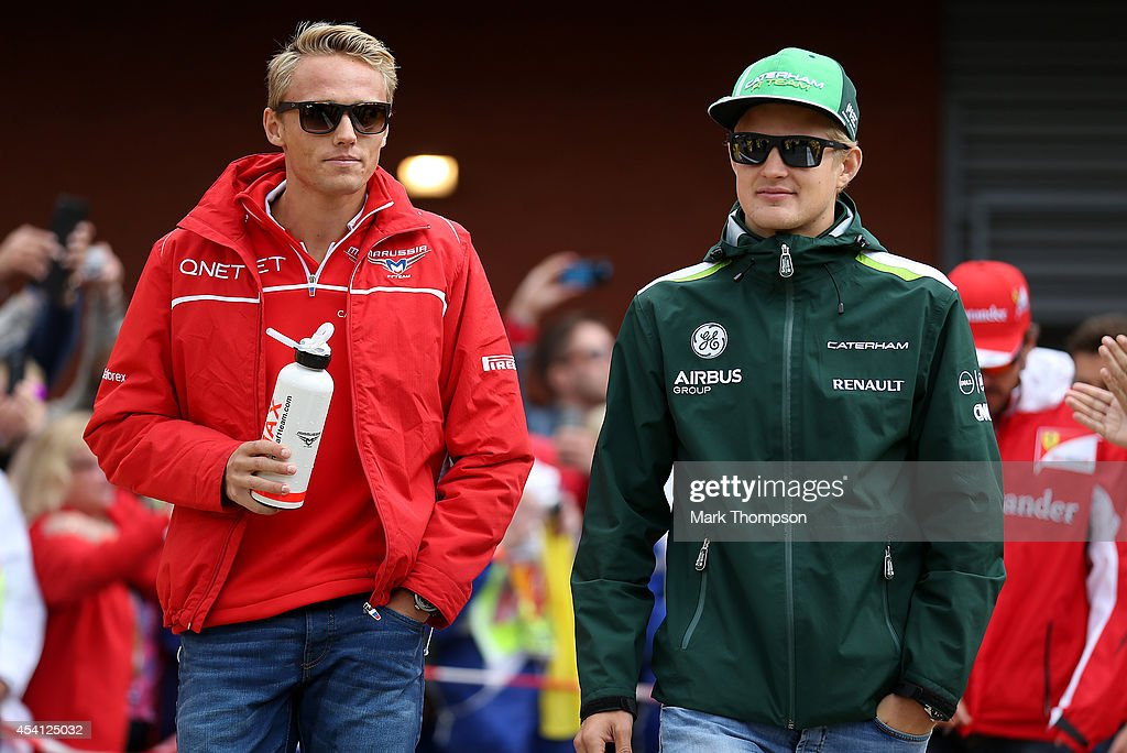Max Chilton of Great Britain and Marussia and Marcus Ericsson of Sweden and Caterham walk out for the drivers' parade before the Belgian Grand Prix at Circuit de Spa-Francorchamps on August 24, 2014 in Spa, Belgium.