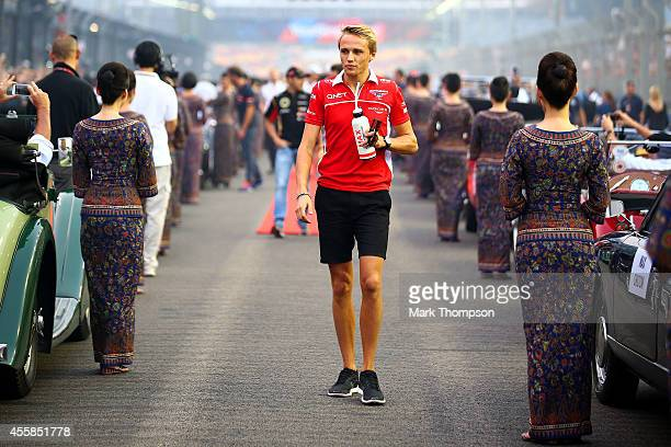 Max Chilton of Great Britain and Marussia arrives for the drivers' parade before the Singapore Formula One Grand Prix at Marina Bay Street Circuit on...