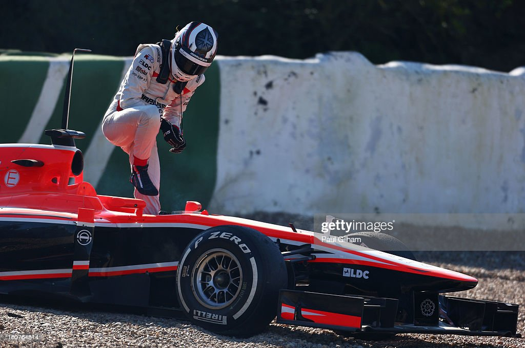 Max Chilton of Great Britain and Marussia climbs out of his car after spinning off the rack during Formula One winter testing at Circuito de Jerez on February 5, 2013 in Jerez de la Frontera, Spain.