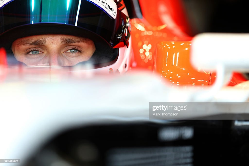 Max Chilton of Great Britain and Marussia sits in his car in the garage during day two of testing at Silverstone Circuit on July 9, 2014 in Northampton, England.