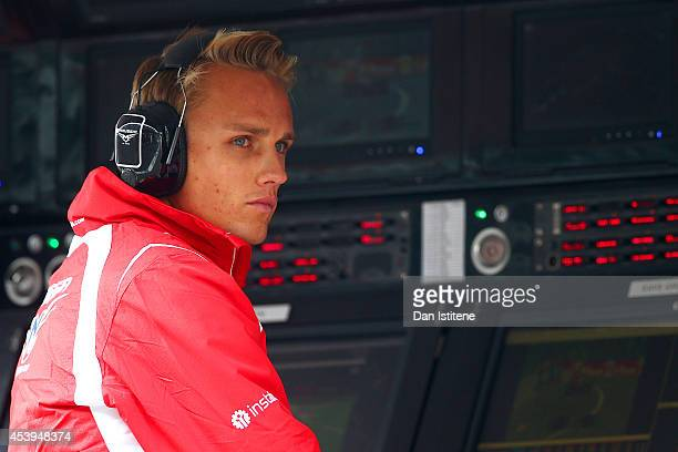 Max Chilton of Great Britain and Marussia sits on the pit wall during practice ahead of the Belgian Grand Prix at Circuit de SpaFrancorchamps on...