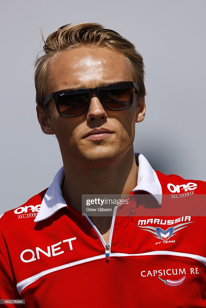 Max Chilton of Great Britain and Marussia walks along the track with members of his team during previews ahead of the German Grand Prix at Hockenheimring on July 17, 2014 in Hockenheim, Germany.