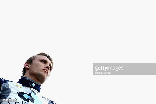 Max Chilton of Great Britian driver of the Gallagher Chip Ganassi Racing Chevrolet looks on prior to the Verizon IndyCar Series Firestone 600 at...