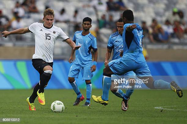 Max Christiansen of Germany and Jale Dreloa of Fiji compete for the ball during the Men's Group C match between Germany and Fiji on Day 5 of the...