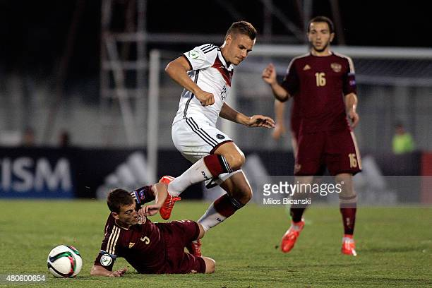 Max Christiansen of Germany competes with Ramil Sheydarev of Russia during the UEFA European Under19 Championship group stage match between U19...