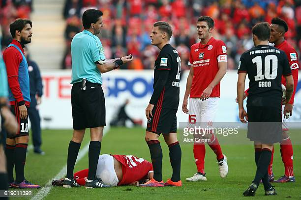 Max Christiansen of Ingolstadt is sent off by referee Manuel Graefe during the Bundesliga match between 1 FSV Mainz 05 and FC Ingolstadt 04 at Opel...