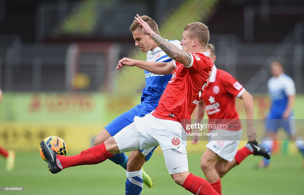 Max Christiansen (L) of Rostock and Richard Weil (R) of Mainz compete for the ball during the Third league match between 1. FSV Mainz 05 II and Hansa Rostock at Bruchweg Stadium on August 29, 2014 in Mainz, Germany.