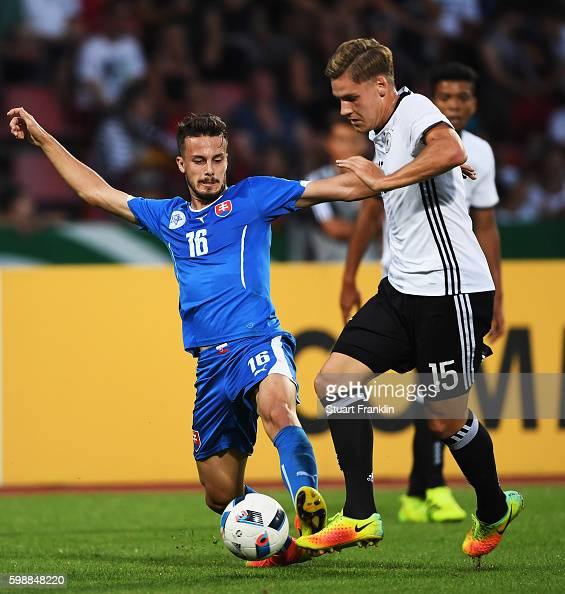 Max Christiansenof Germany is challenged by Jakub Hromada of Slovakia during the Under21 friendly match between U21 Germany and U21 Slovakia at...