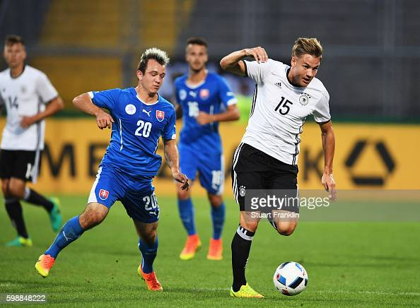 Max Christiansenof Germany is challenged by Miroslav Kacer of Slovakia during the Under21 friendly match between U21 Germany and U21 Slovakia at...