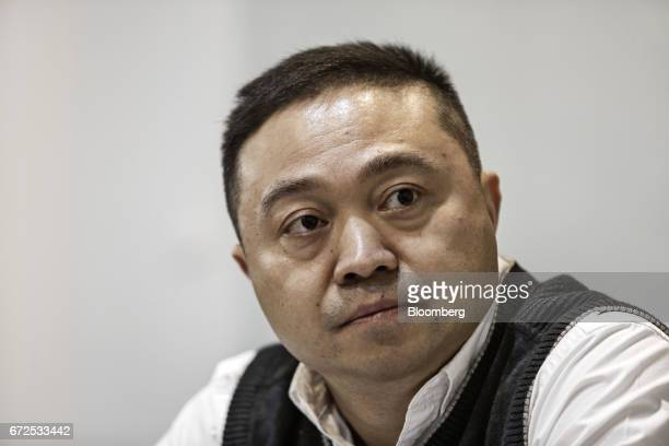 Max Chu general manager at EDeodar Robot Equipment Co a whollyowned subsidiary of Ningbo Techmation Co listens during an interview at the company's...