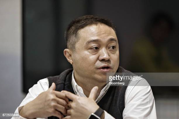 Max Chu general manager at EDeodar Robot Equipment Co a whollyowned subsidiary of Ningbo Techmation Co speaks during an interview at the company's...