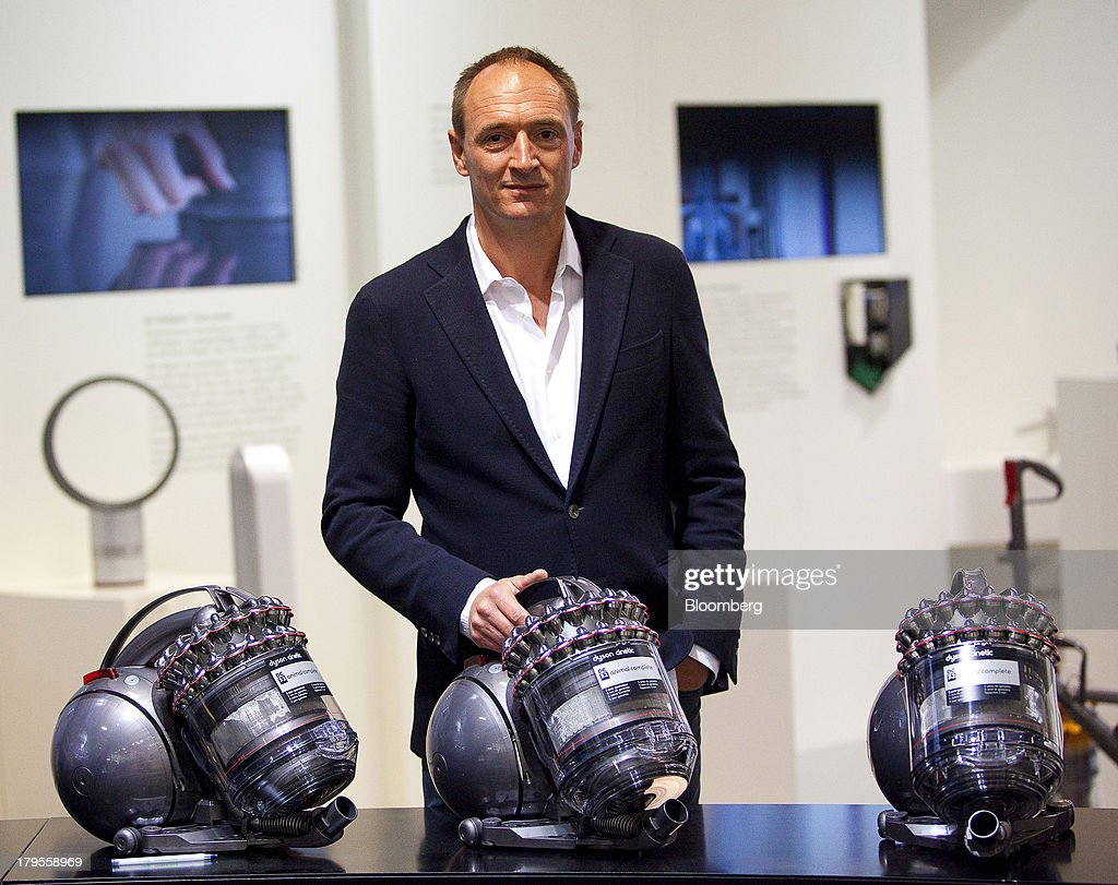 Max Conze, chief executive officer of Dyson Ltd., poses for a photograph with Dyson Cinetic DC 52 Animal Complete vacuum cleaners following a Bloomberg Television interview on the eve of the opening of the IFA consumer electronics show in Berlin, Germany, on Thursday, Sept. 5, 2013. Samsung showed the Galaxy Gear yesterday at IFA, Europe's largest consumer-electronics show, as it races Apple and Sony Corp. to carve a share of the market for wearable technology amid slowing growth in smartphones. Photographer: Krisztian Bocsi/Bloomberg via Getty Images