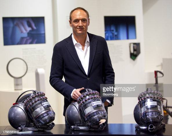 Max Conze chief executive officer of Dyson Ltd poses for a photograph with Dyson Cinetic DC 52 Animal Complete vacuum cleaners following a Bloomberg...