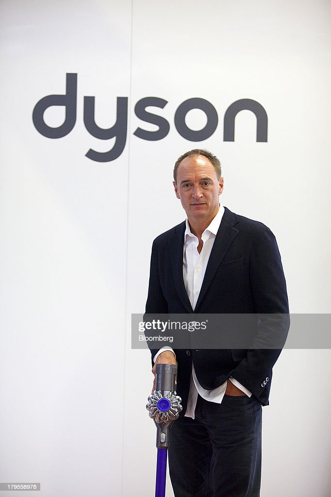 Max Conze, chief executive officer of Dyson Ltd., poses for a photograph with a Dyson Cinetic DC 52 Animal Complete vacuum cleaner following a Bloomberg Television interview on the eve of the opening of the IFA consumer electronics show in Berlin, Germany, on Thursday, Sept. 5, 2013. Samsung showed the Galaxy Gear yesterday at IFA, Europe's largest consumer-electronics show, as it races Apple and Sony Corp. to carve a share of the market for wearable technology amid slowing growth in smartphones. Photographer: Krisztian Bocsi/Bloomberg via Getty Images