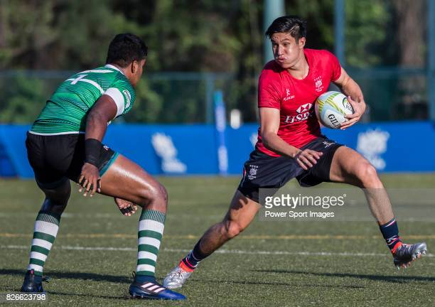 Max Denmark of Hong Kong is tackled by Lahiru Herath Mudiyanselage of Sri Lanka during the Asia Rugby U20 Sevens 2017 at King's Park Sports Ground on...