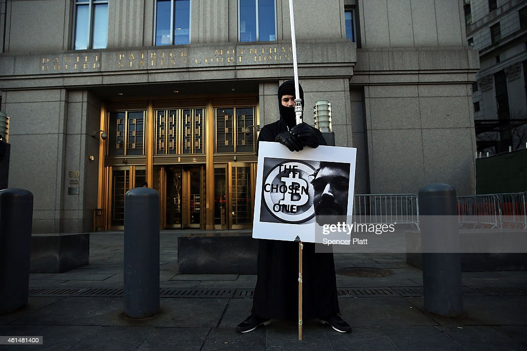 Max Dickstein stands with other supporters of Ross Ulbricht the alleged creator and operator of the Silk Road underground market in front of a...