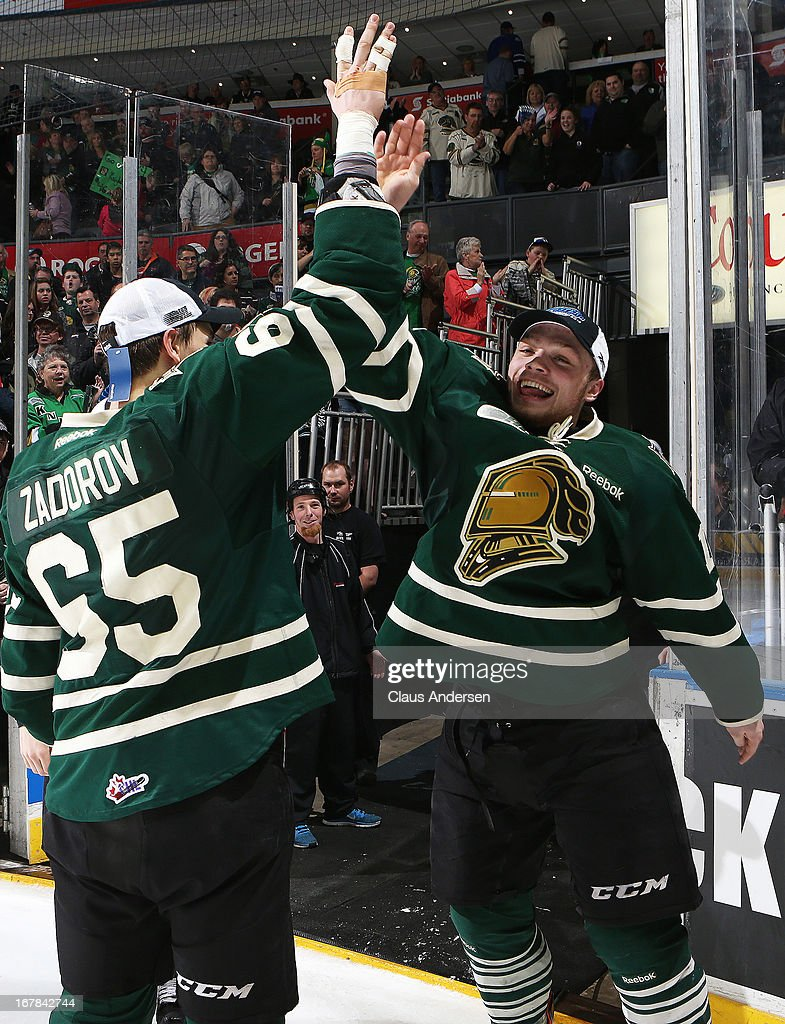 Max Domi #16 and Nikita Zadorov #65 of the London Knights celebrate their win in Game Five of the Western Conference Final against the Plymouth Whalers on April 26, 2013 at the Budweiser Gardens in London, Ontario, Canada. The Knights defeated the Whalers 5-4 in overtime to win the series 4-1.