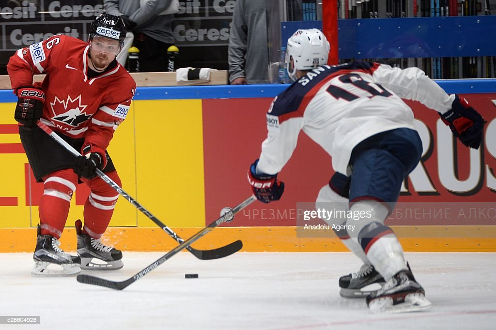 Max Domi of Canada (L) vies with Steve Santini of USA (R) the IIHF ice hockey world championship preliminary round Group B game between USA and Canada, on May 06, 2016, St. Petersburg, Russia.