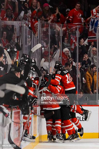 Max Domi of Team Canada celebrates his goal with teammates in a preliminary round game during the 2015 IIHF World Junior Hockey Championships against...