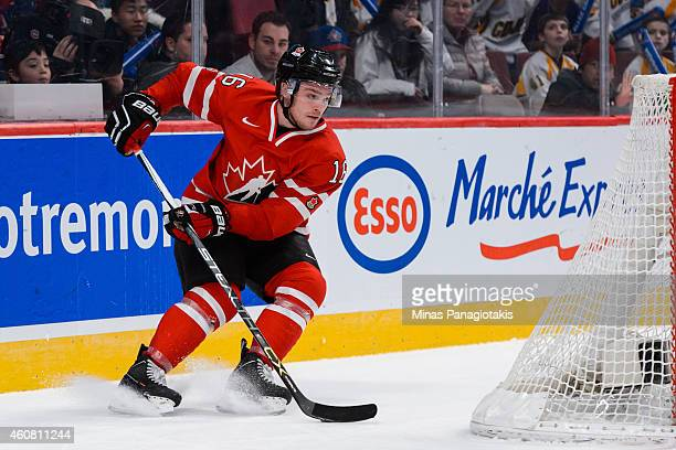 Max Domi of Team Canada puts on the breaks behind the net during the 2015 IIHF World Junior Hockey Championship exhibition game against Team...