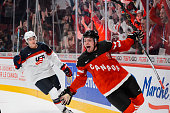 Max Domi of Team Canada scores an empty net goal to secure Team Canada's win over Team United States in a preliminary round game during the 2015 IIHF...